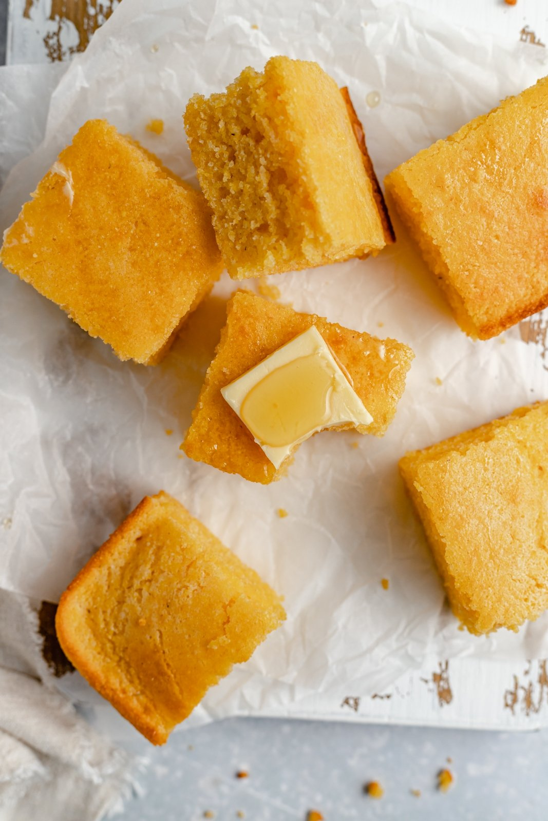 moist cornbread cut into slices and topped with butter