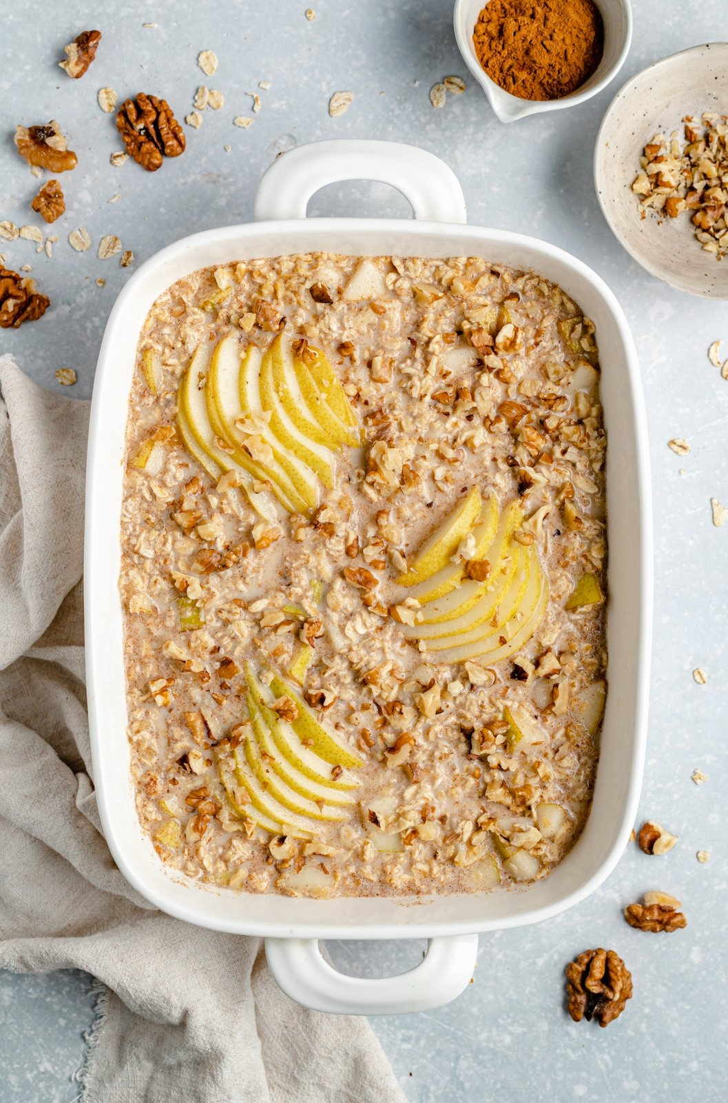 unbaked pear oatmeal bake in a baking dish