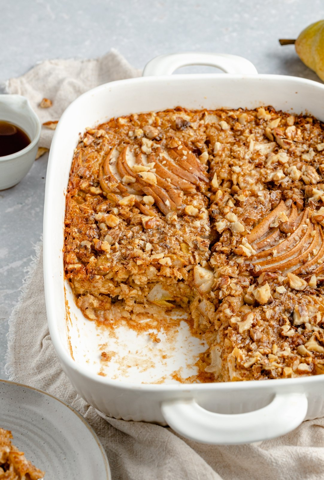 pear oatmeal bake in a baking dish with a slice cut out