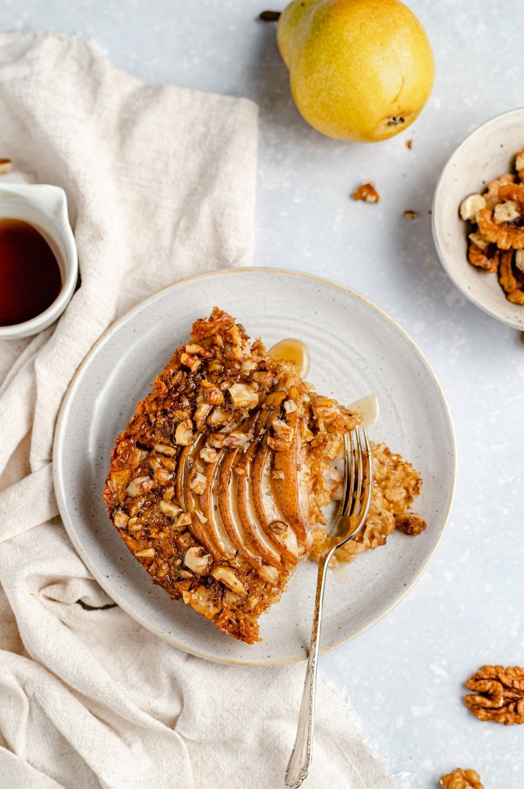 slice of pear baked oatmeal on a plate