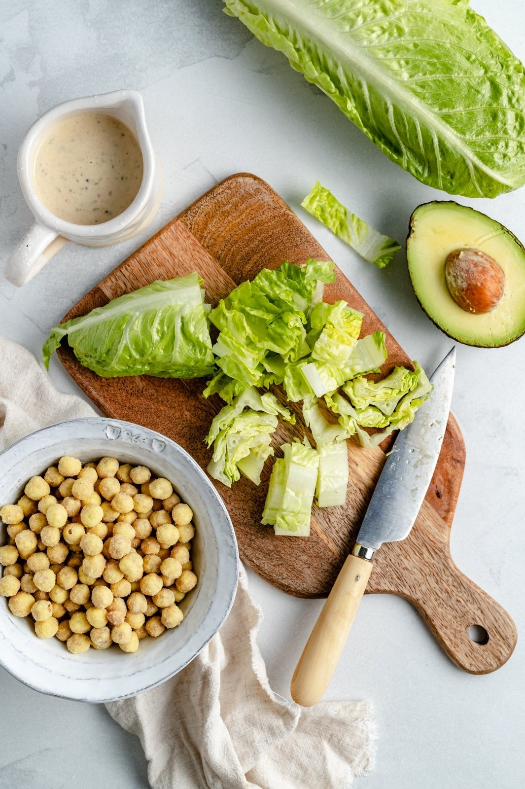ingredients for vegan caesar salad recipe on a board