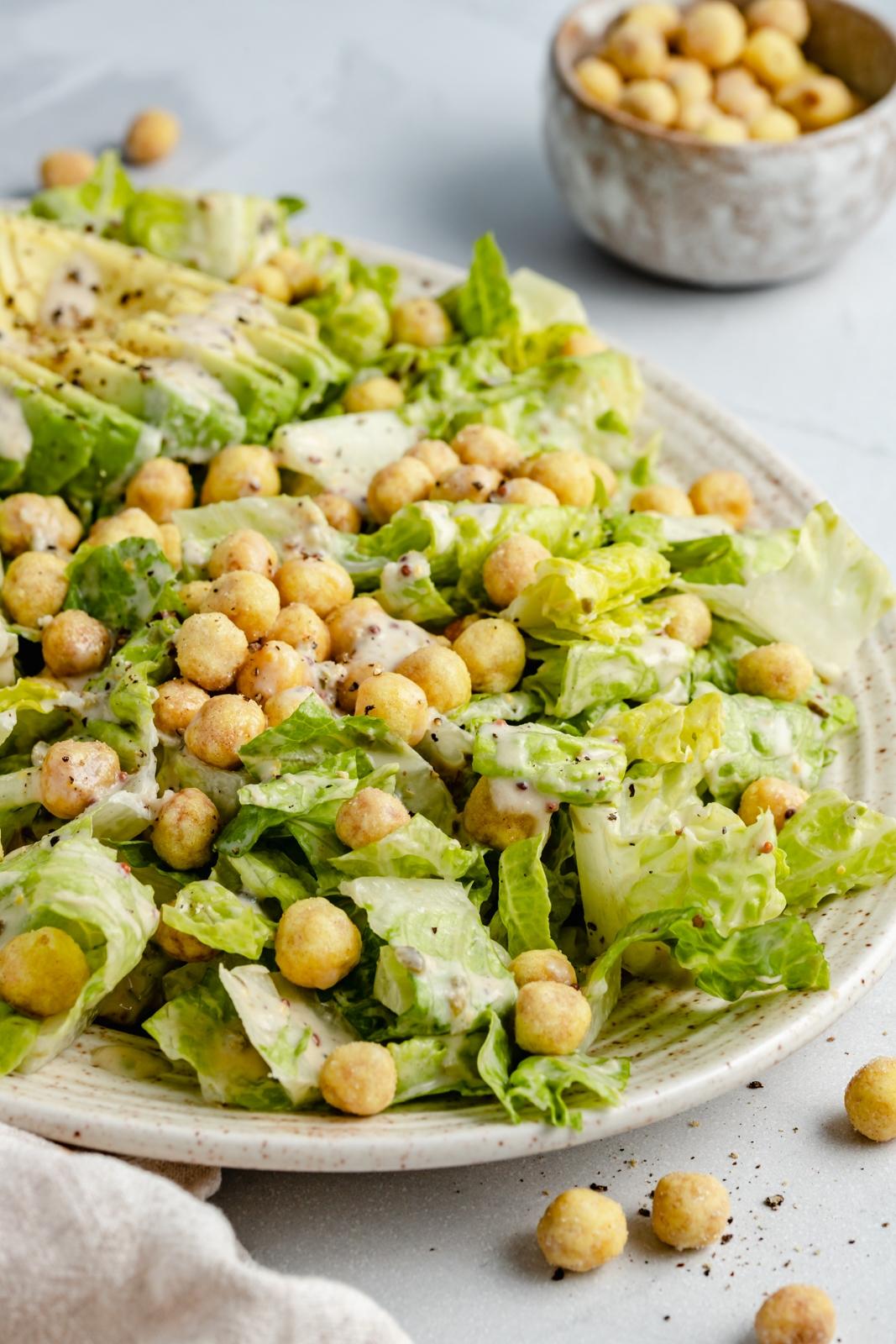easy vegan caesar salad with chickpeas on a platter