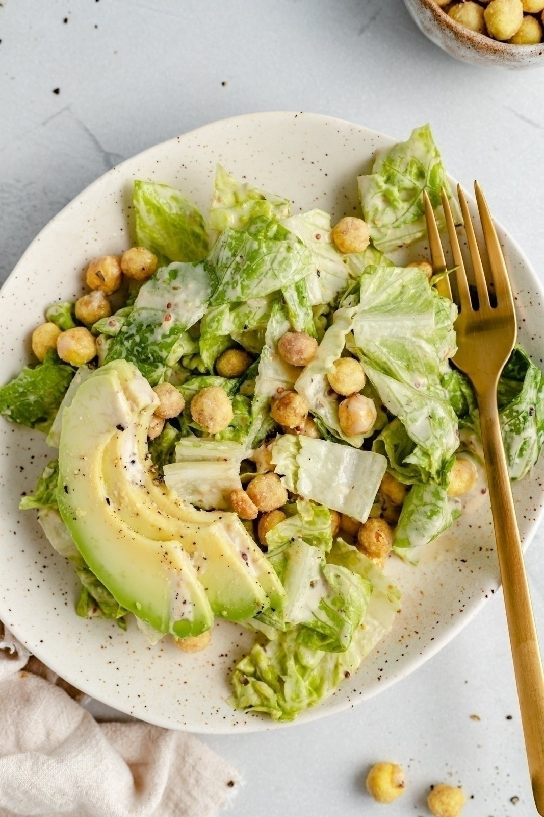 the best vegan caesar salad on a plate with a fork