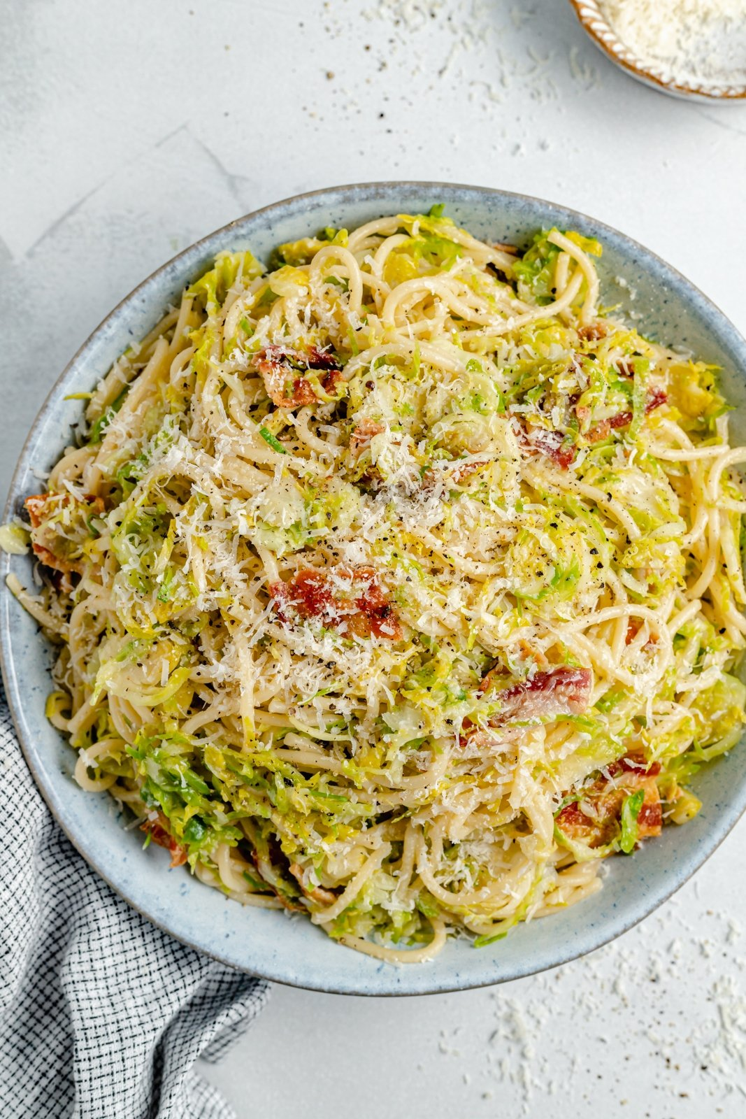 brussels sprouts spaghetti with bacon in a bowl