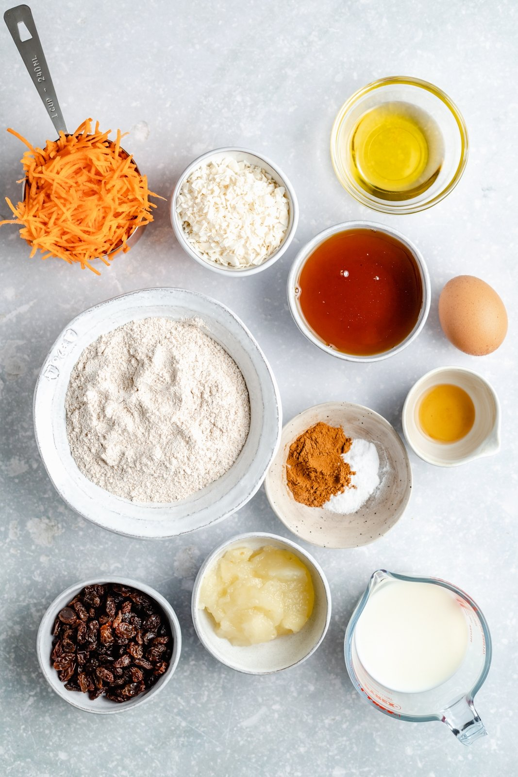 ingredients for carrot cake muffins on a grey board
