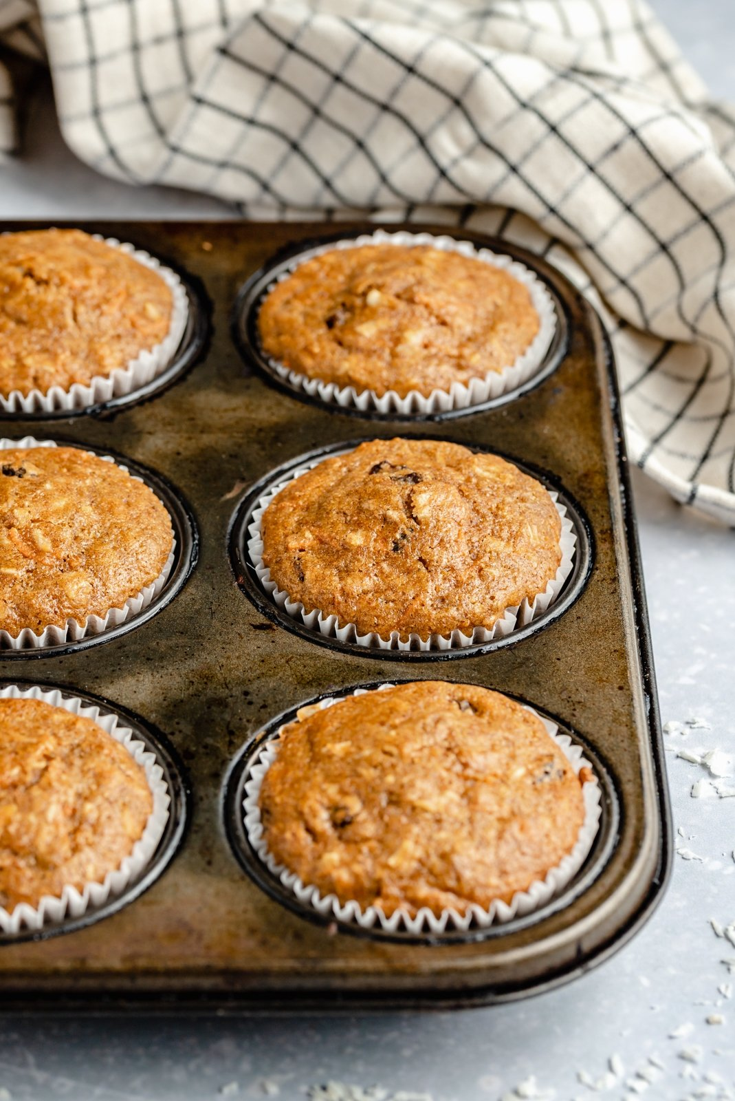 healthy carrot cake muffins in a muffin tin