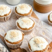 healthy carrot cake muffins on a wooden board