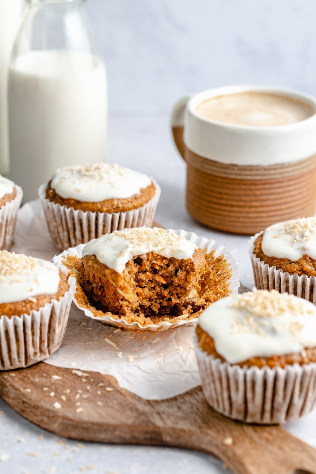 carrot cake muffin with a bite taken out