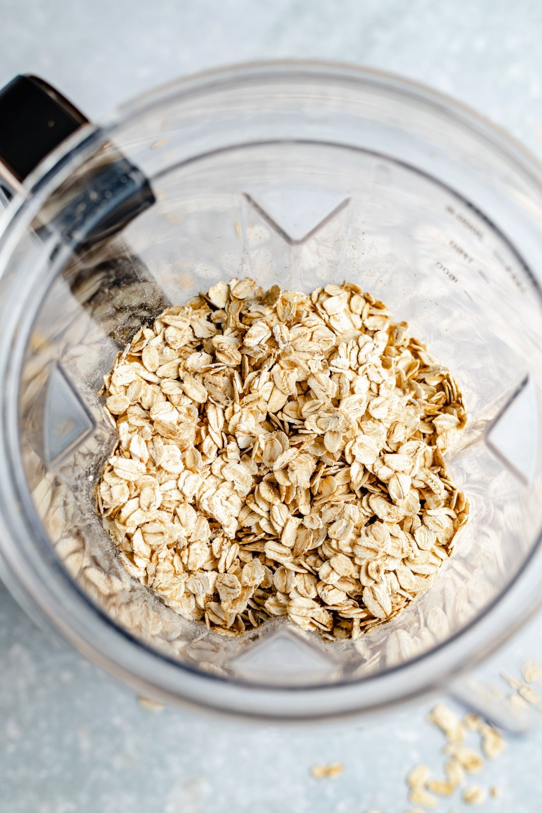 rolled oats in a blender to make homemade oat flour