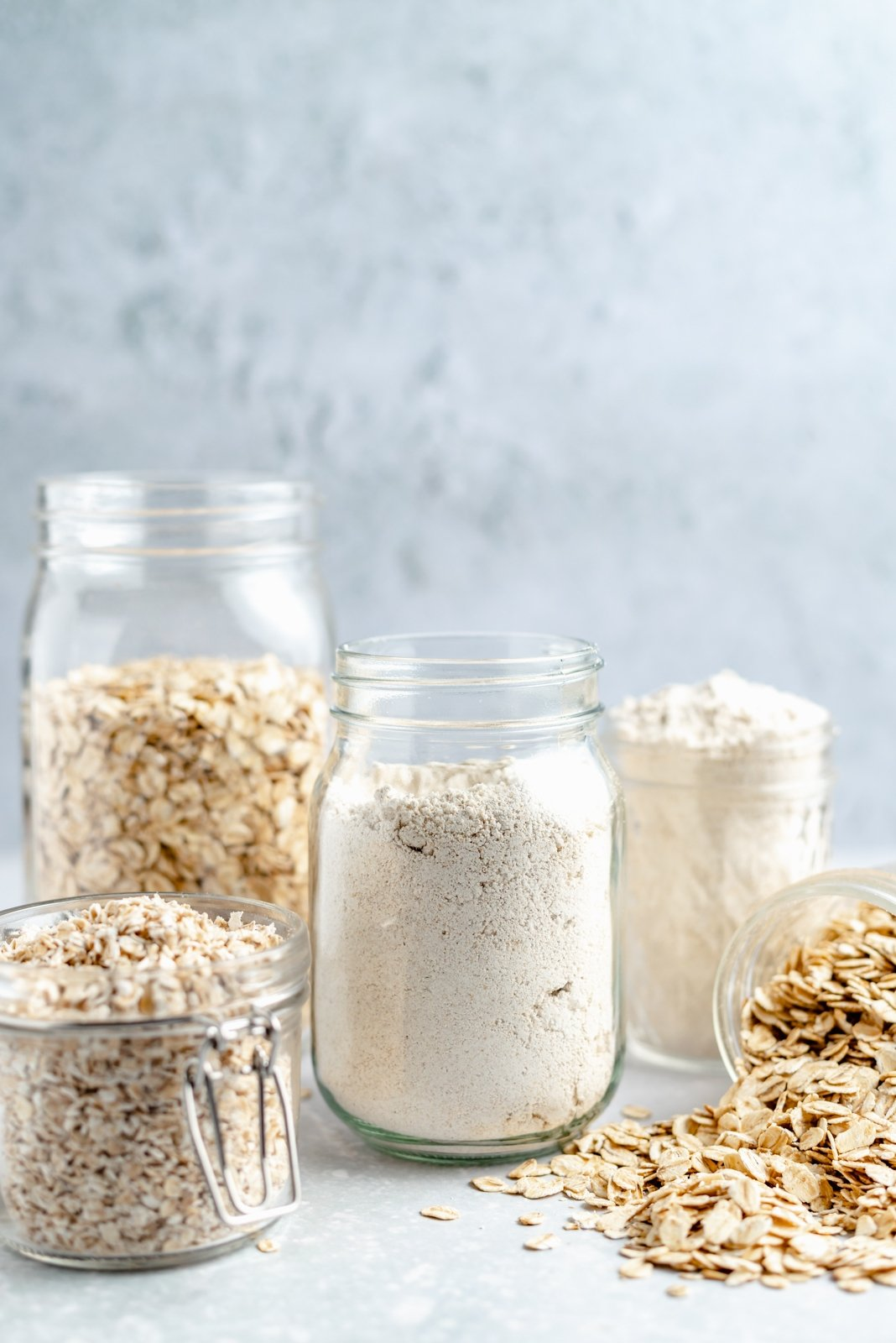 oats and homemade oat flour in jars