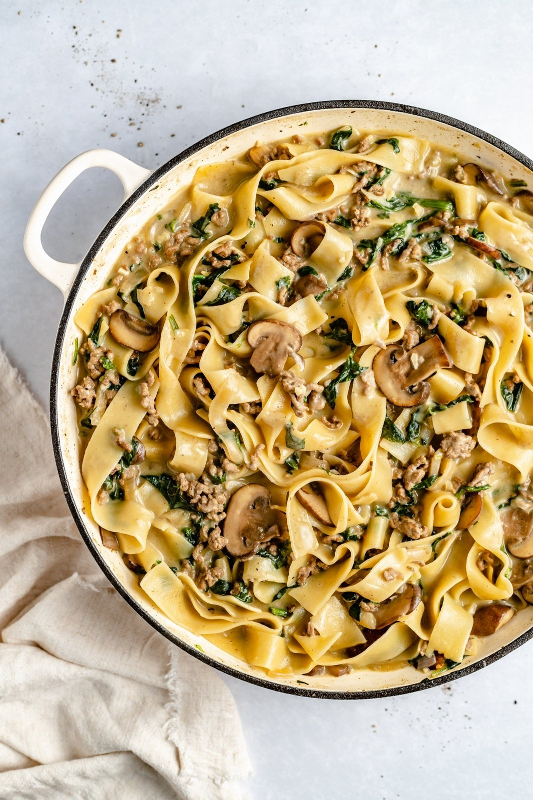 beef and spinach pasta in a pot