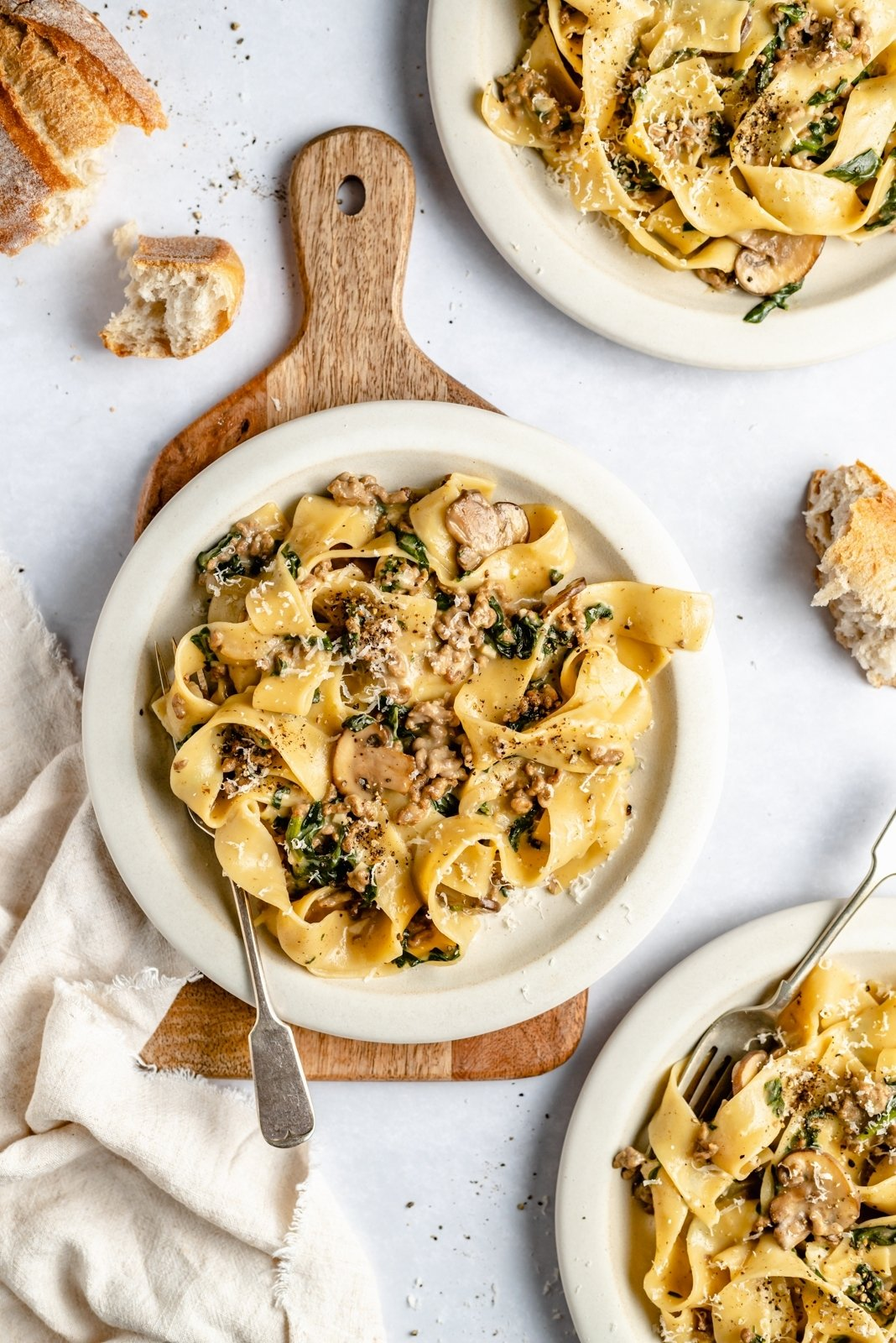 creamy spinach and beef pasta on plates