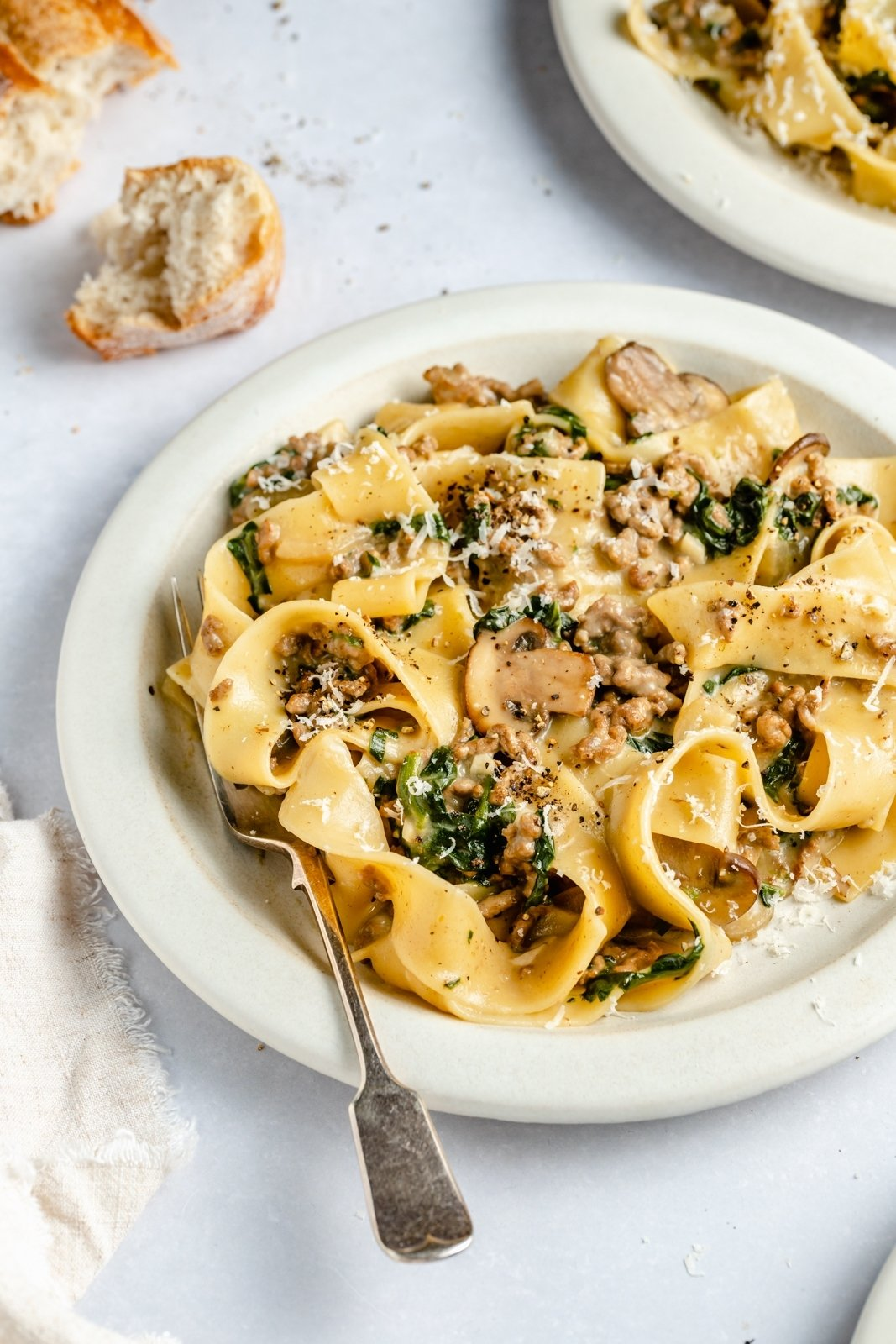 spinach beef pasta recipe on a plate with a fork