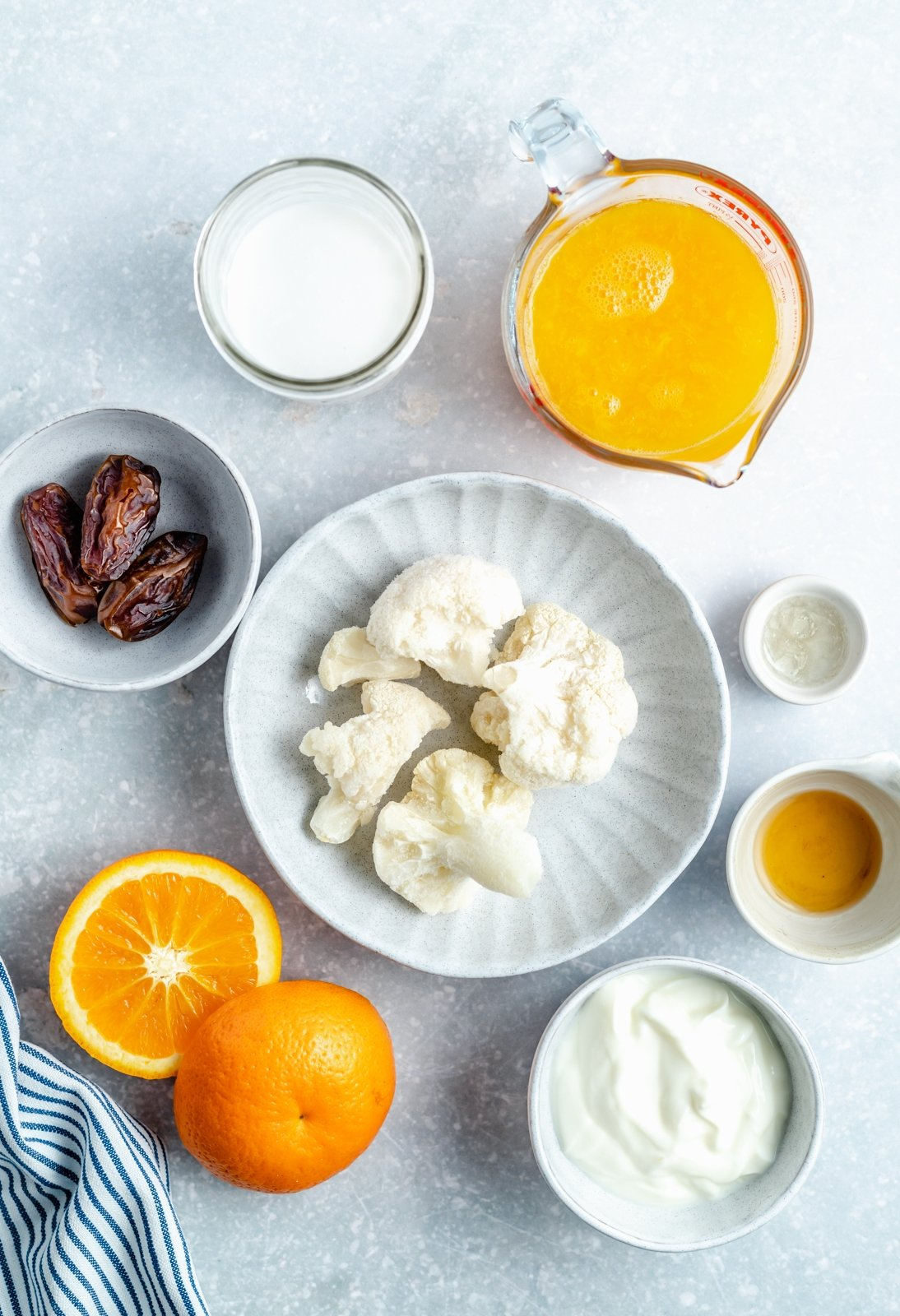 ingredients for an orange smoothie in bowls