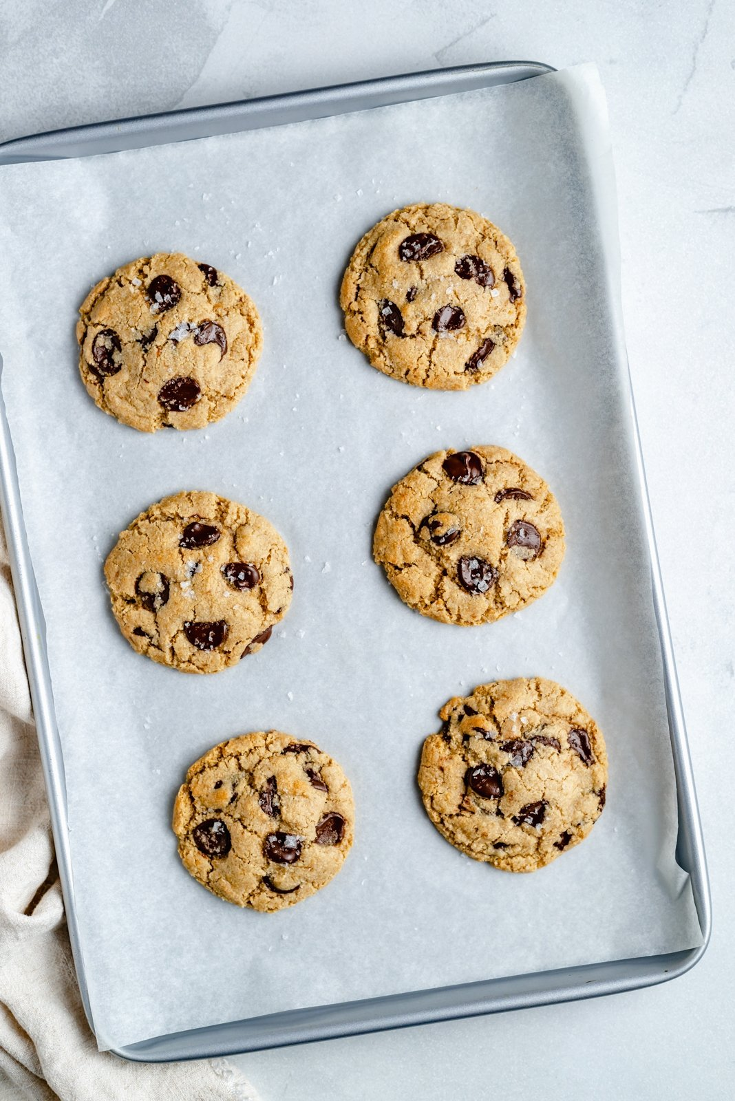 the best vegan chocolate chip cookies on a baking sheet