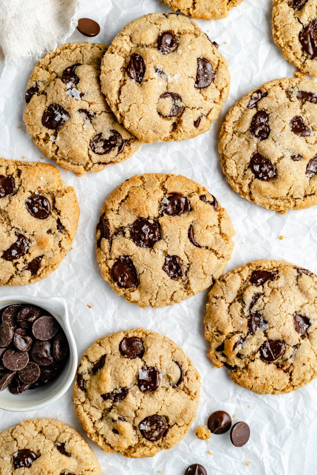 gluten free vegan chocolate chip cookies on parchment paper