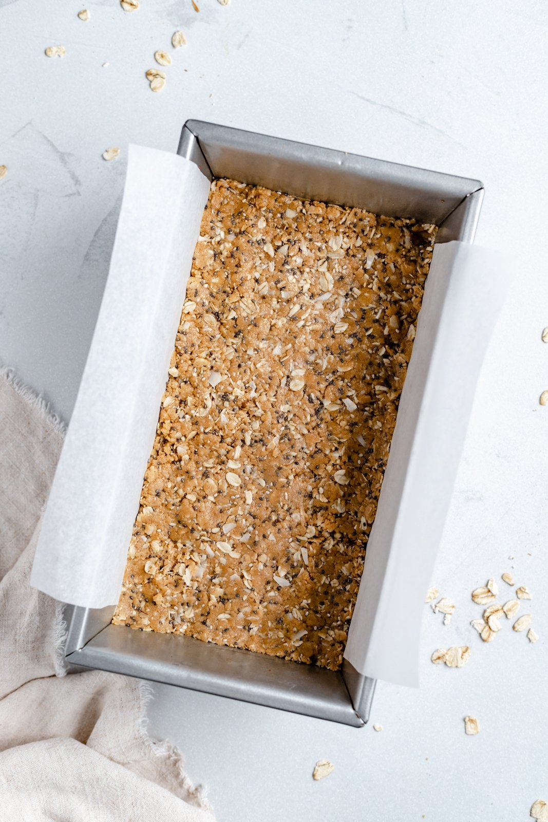 no bake chocolate and coconut protein bars in a loaf pan