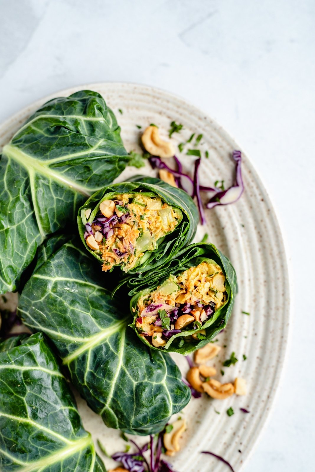 curry chickpea collard wraps on a plate