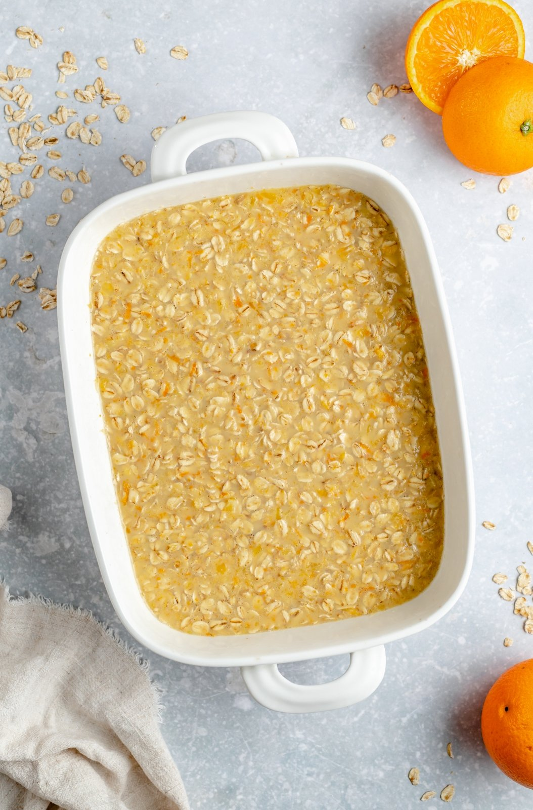 unbaked orange baked oatmeal in a rectangular baking dish