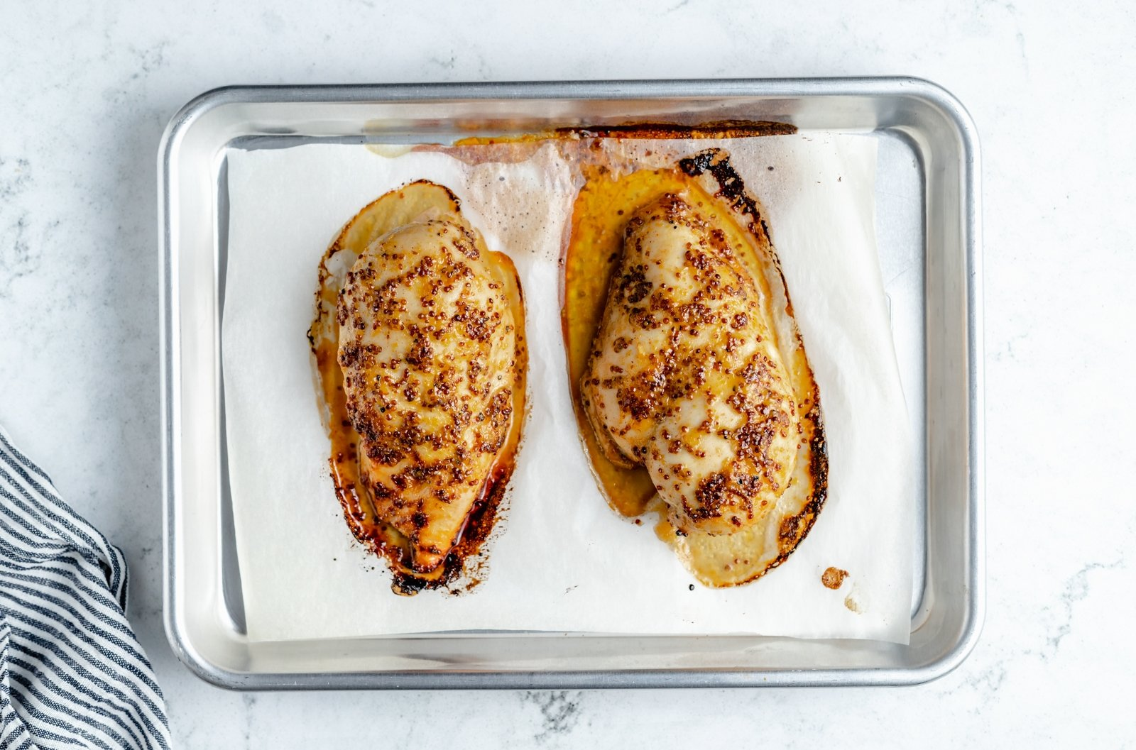 perfect baked chicken breast on a baking sheet