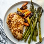 baked chicken breast on a plate with vegetables