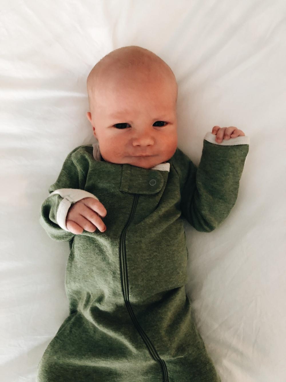 baby viggo in a green onesie