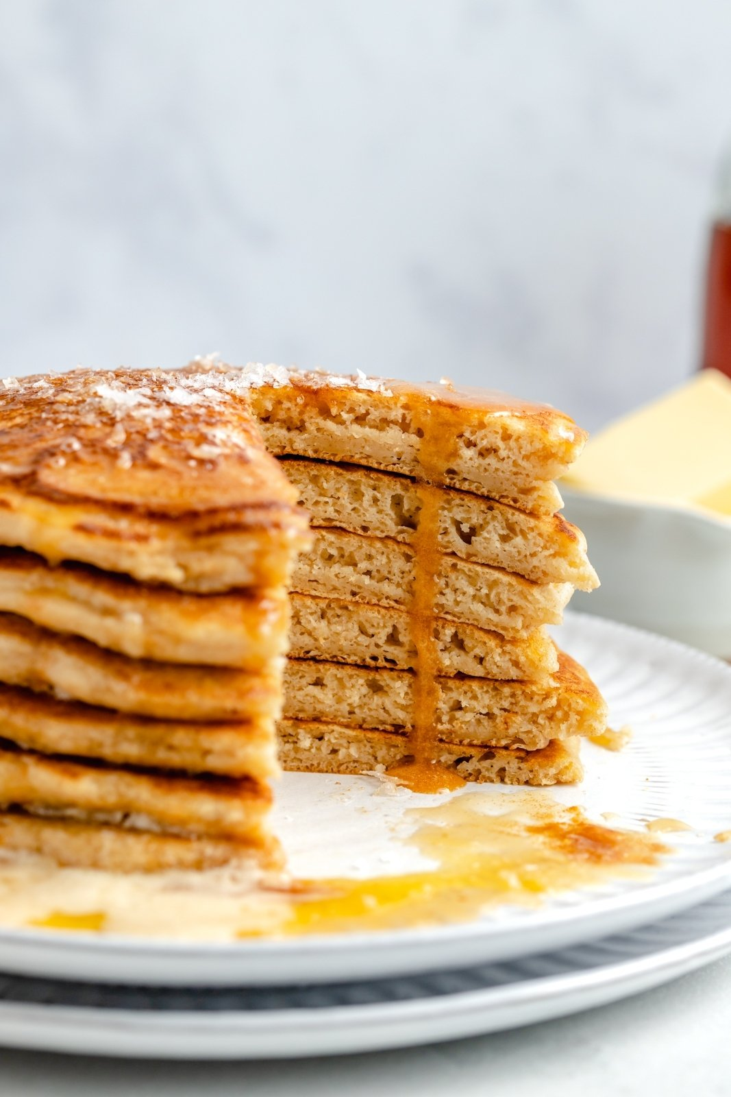 stack of brown butter pancakes with a bite cut out