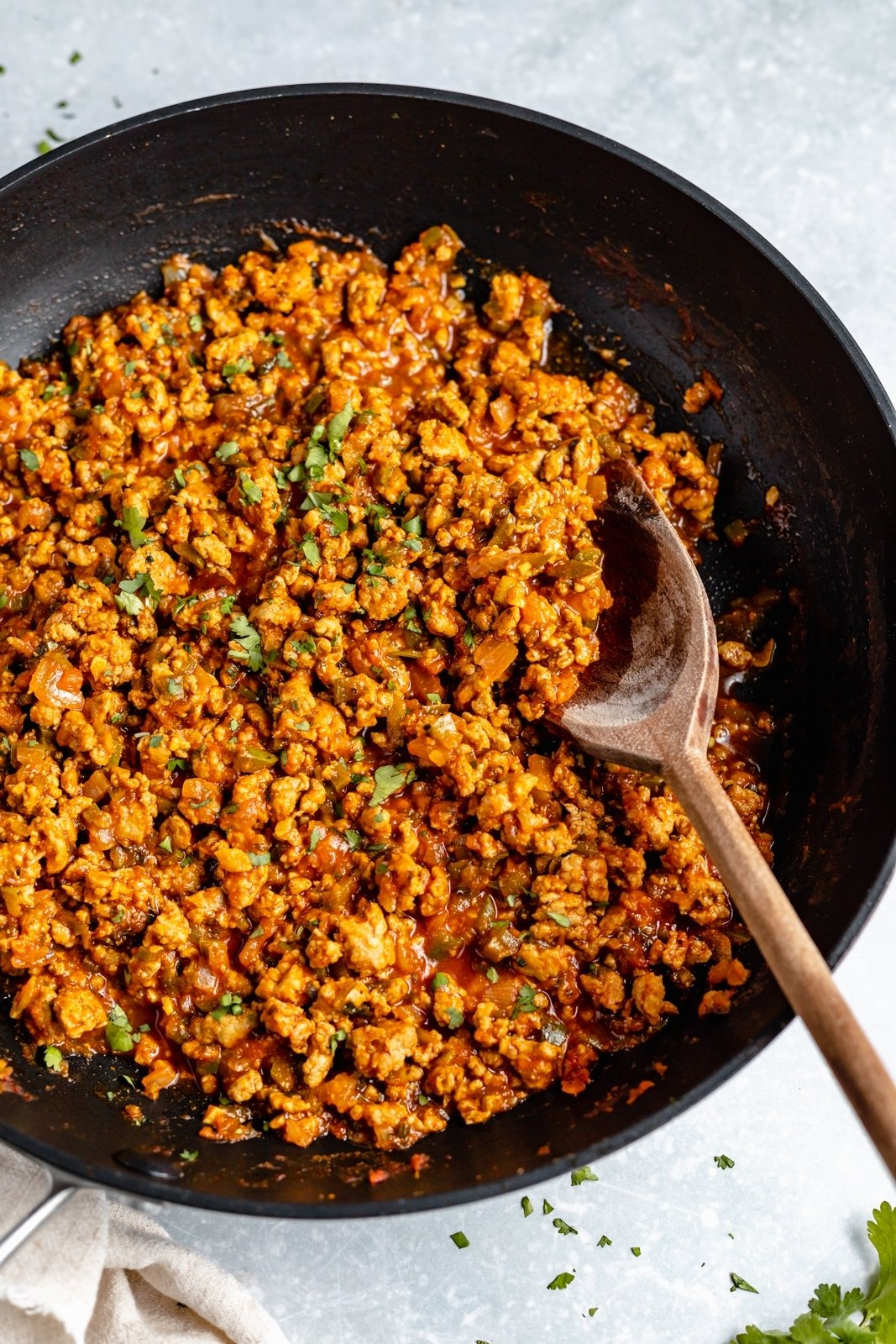 cooking homemade turkey picadillo in a skillet