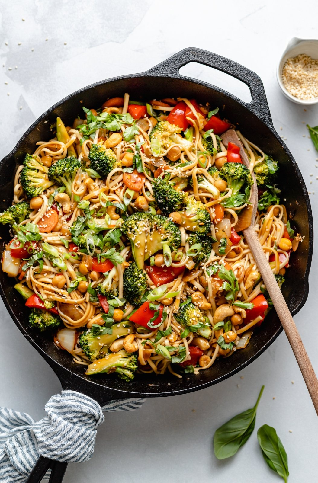 sesame noodles with vegetables in a skillet
