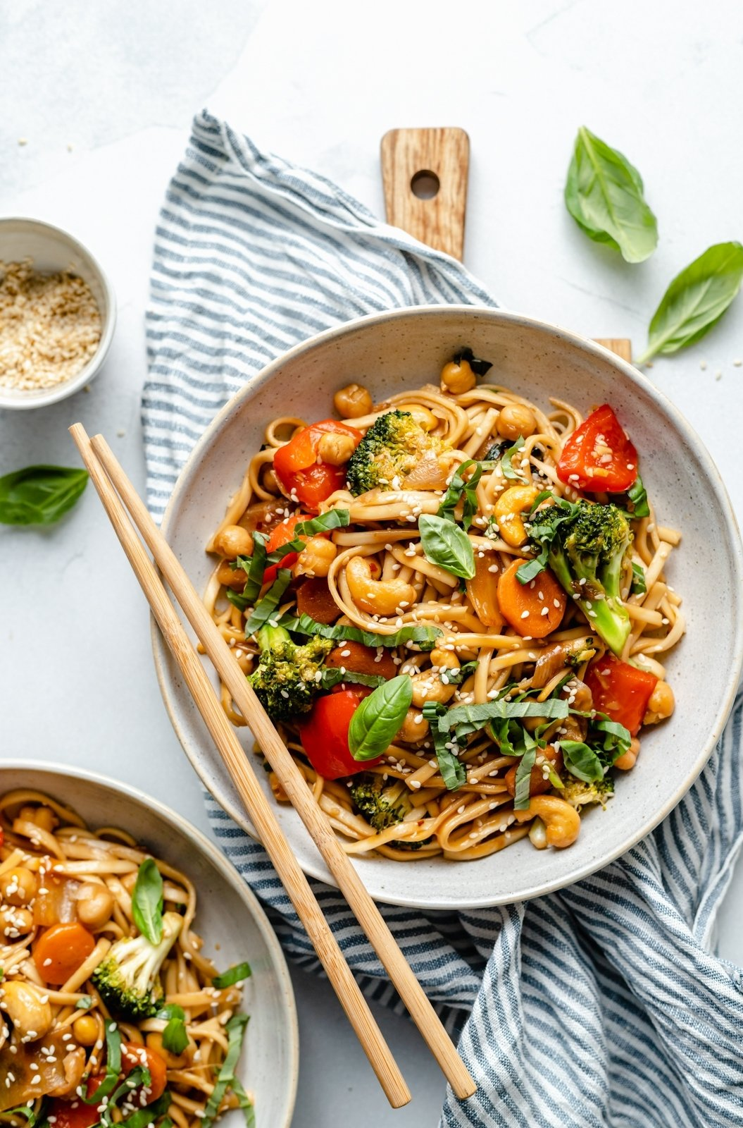 easy vegan stir fry noodles in a bowl with chopsticks