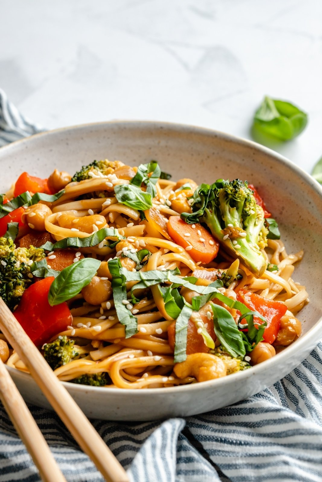vegan stir fry noodles in a bowl with veggies