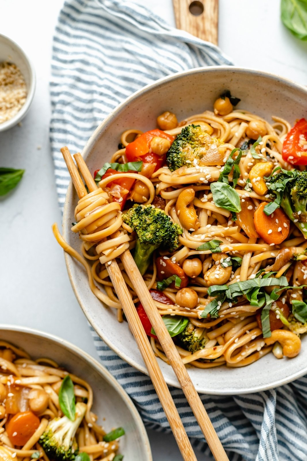 stir fry noodles in a bowl with vegetables and chopsticks