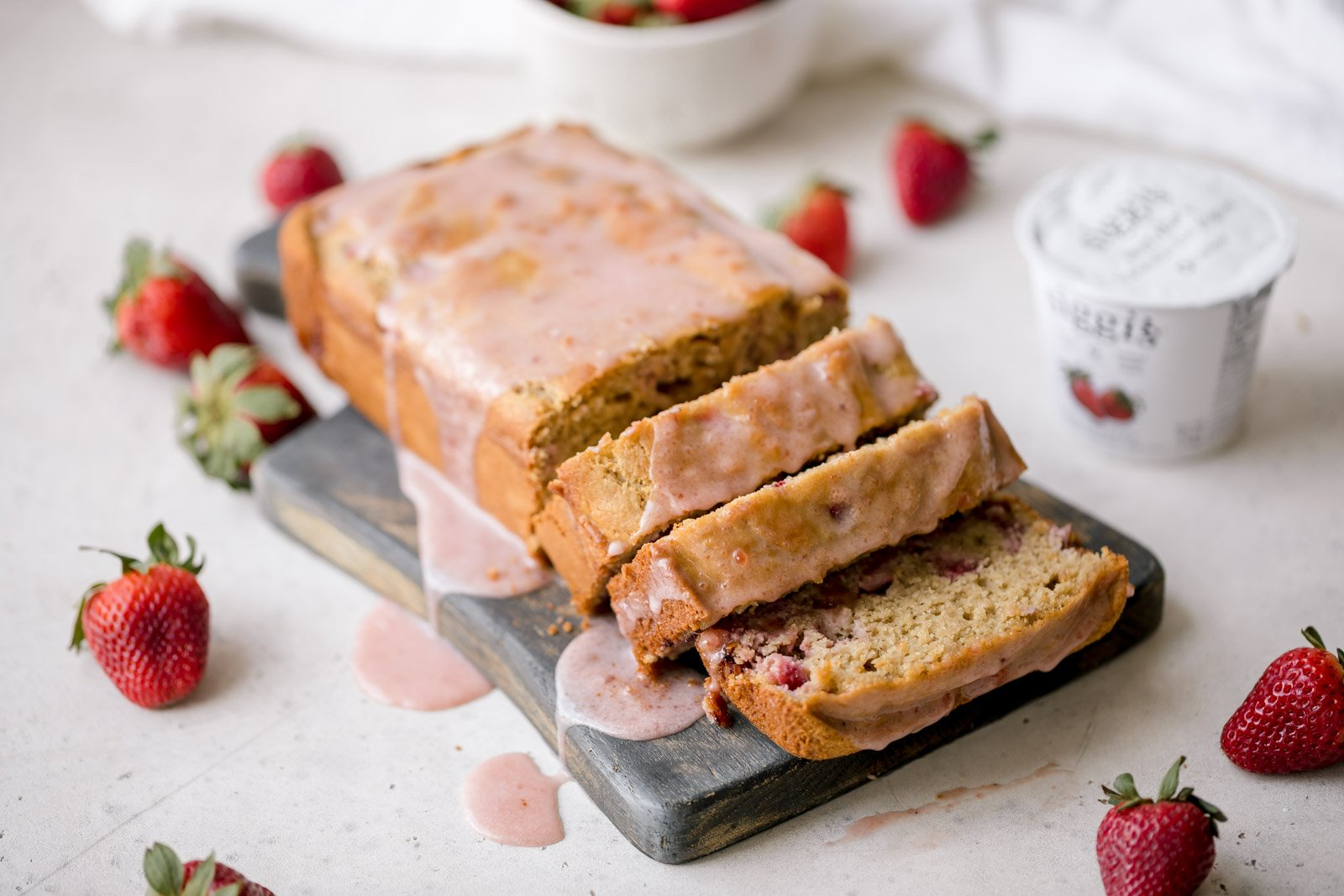 healthy strawberry bread sliced on a cutting board