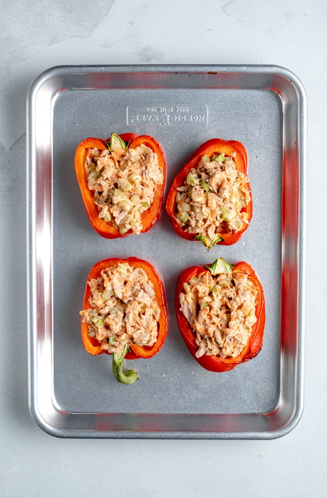 low carb tuna stuffed peppers on a baking sheet