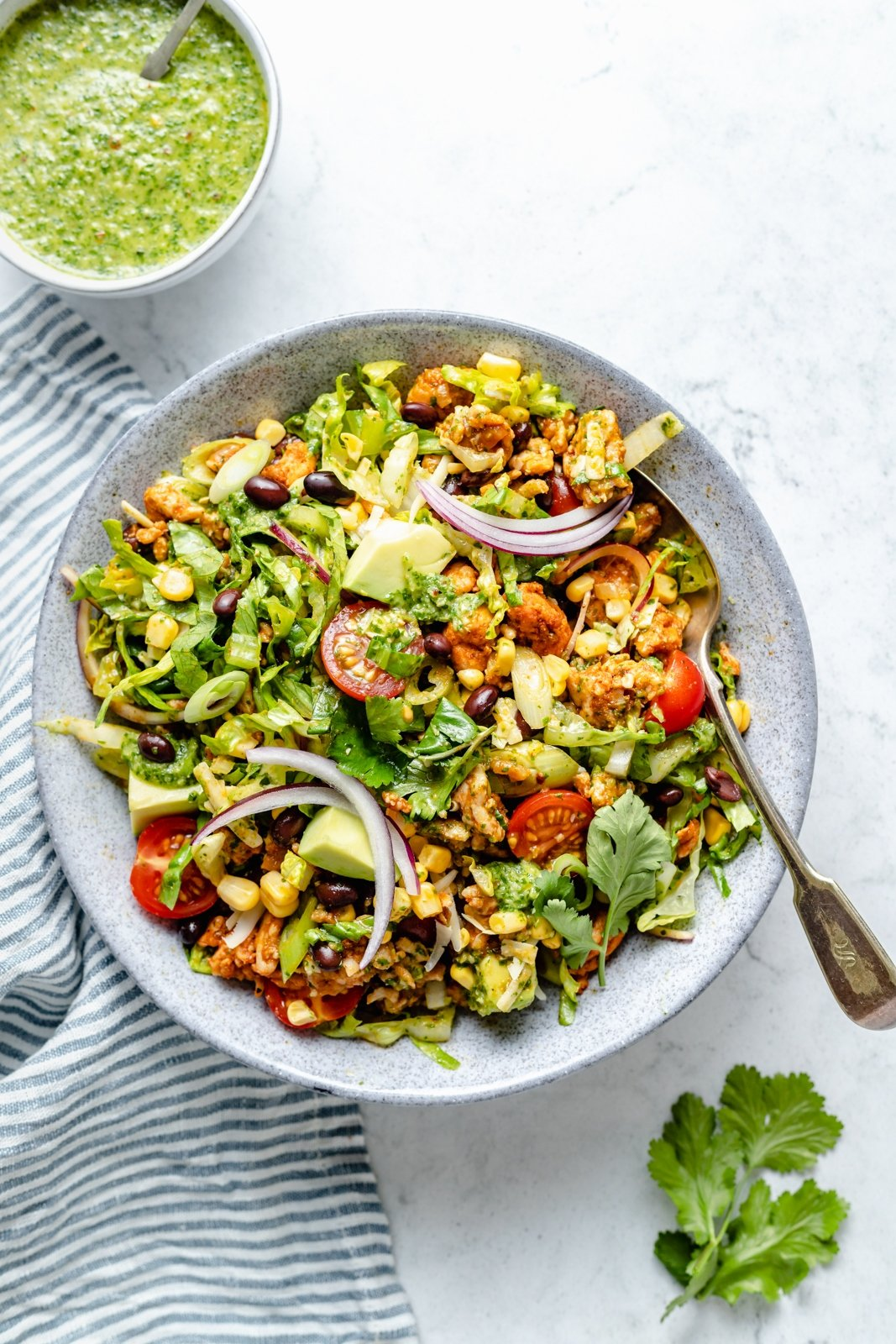 healthy chicken taco salad with black beans and corn in a bowl