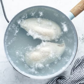 poaching chicken breasts in a pot