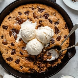 grain free chocolate chunk skillet cookie topped with ice cream