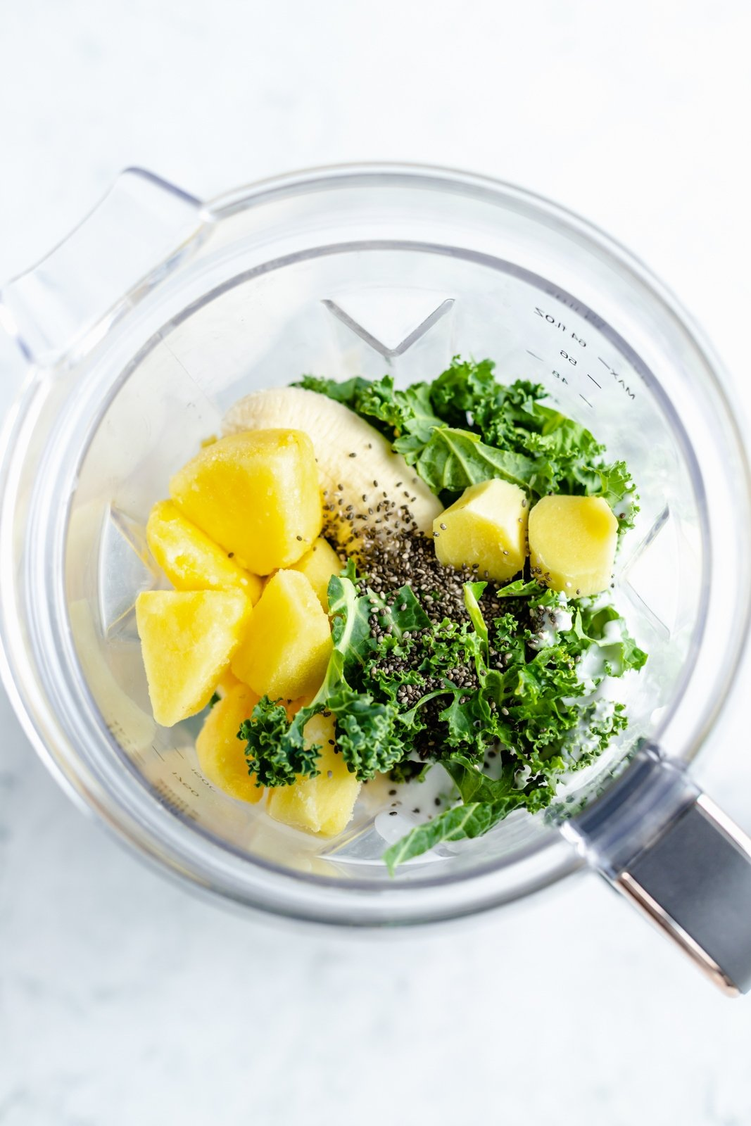 ingredients for a kale smoothie in a blender