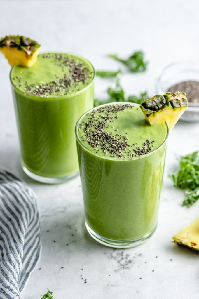 two pineapple kale smoothies in glasses
