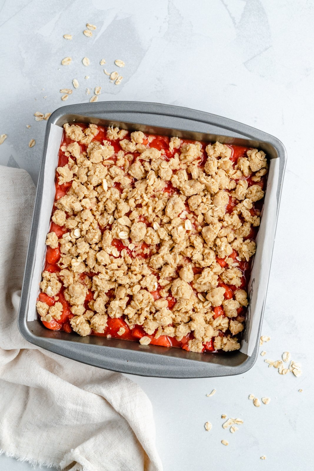 healthy strawberry crumble bars in a pan
