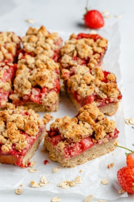 gluten free strawberry crumble bars sliced on parchment paper