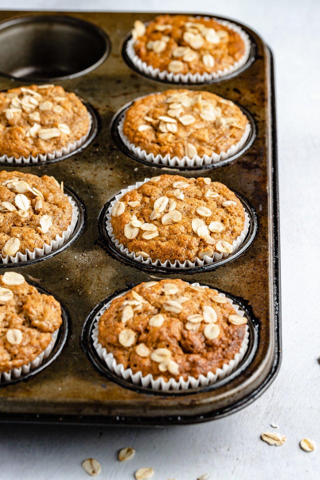 fluffy vegan banana muffins in a muffin tin