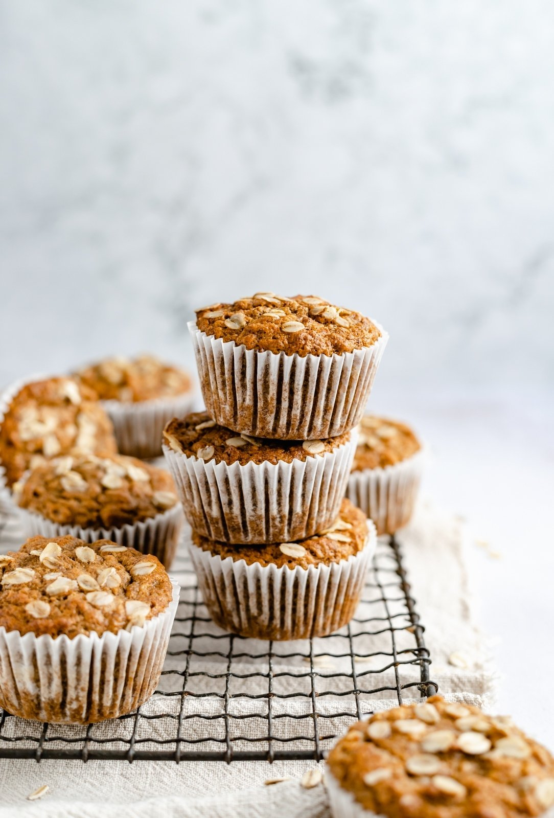 easy vegan banana oatmeal muffins in a stack on a wire rack