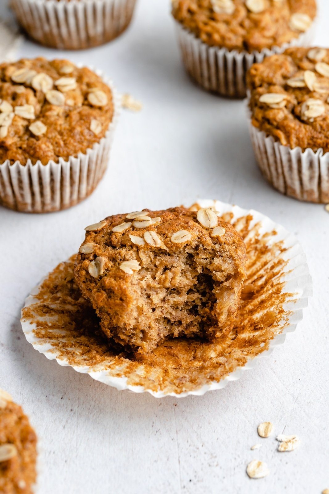vegan banana oatmeal muffin with a bite taken out