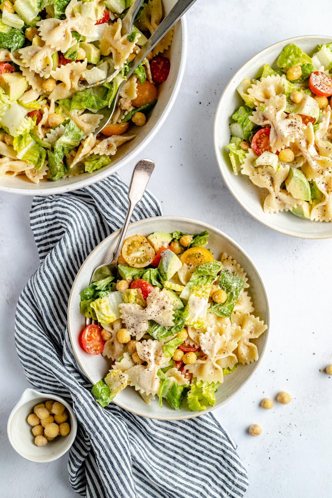 vegan caesar pasta salad in three bowls