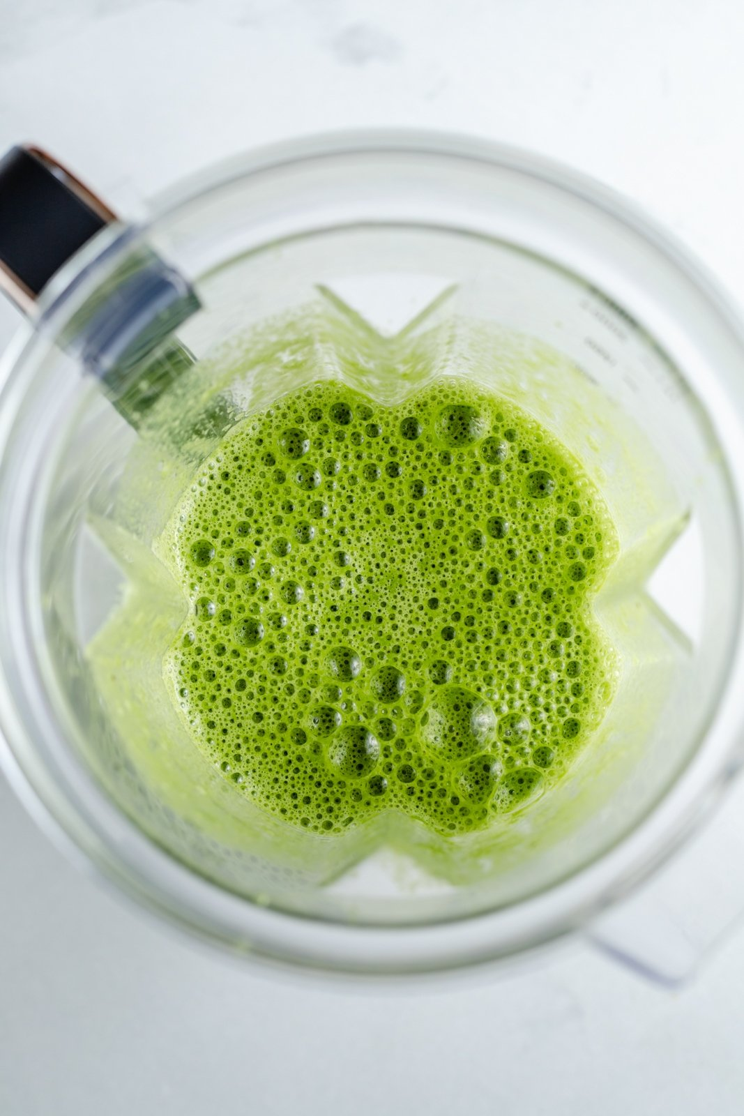 top down view of spinach banana muffin batter in a blender