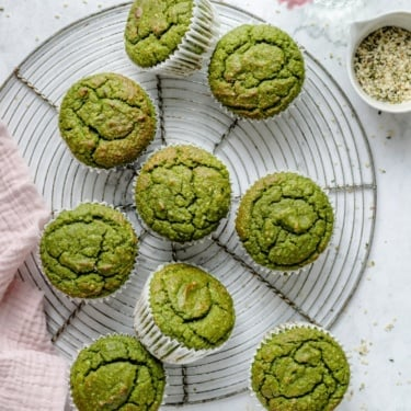 banana spinach muffins on a wire rack