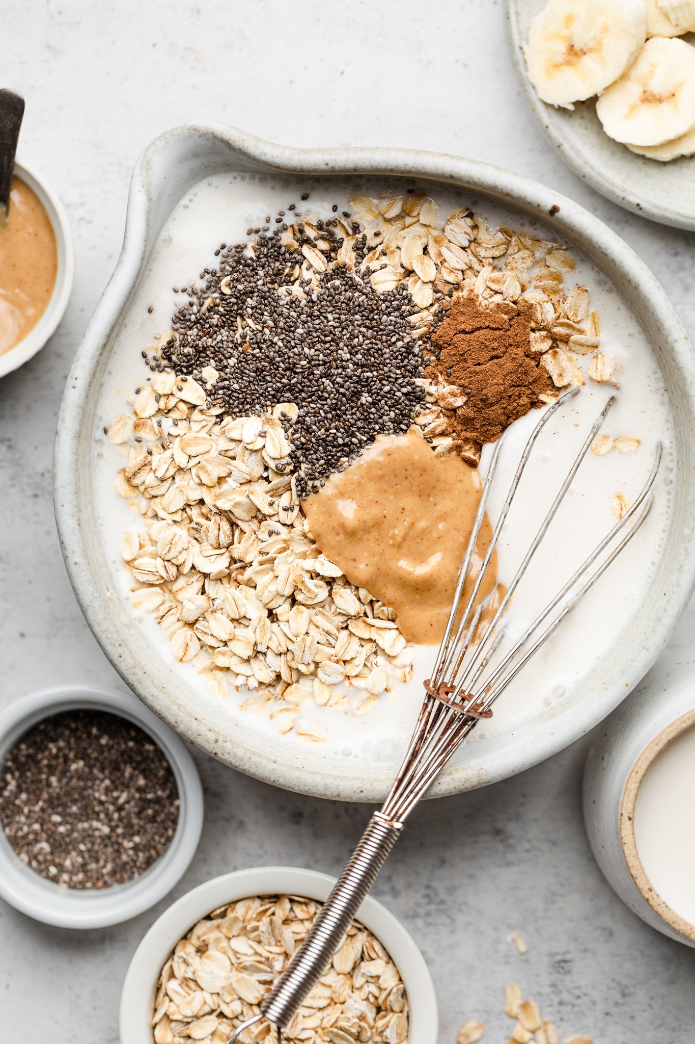 whisking ingredients in a bowl for peanut butter overnight oats