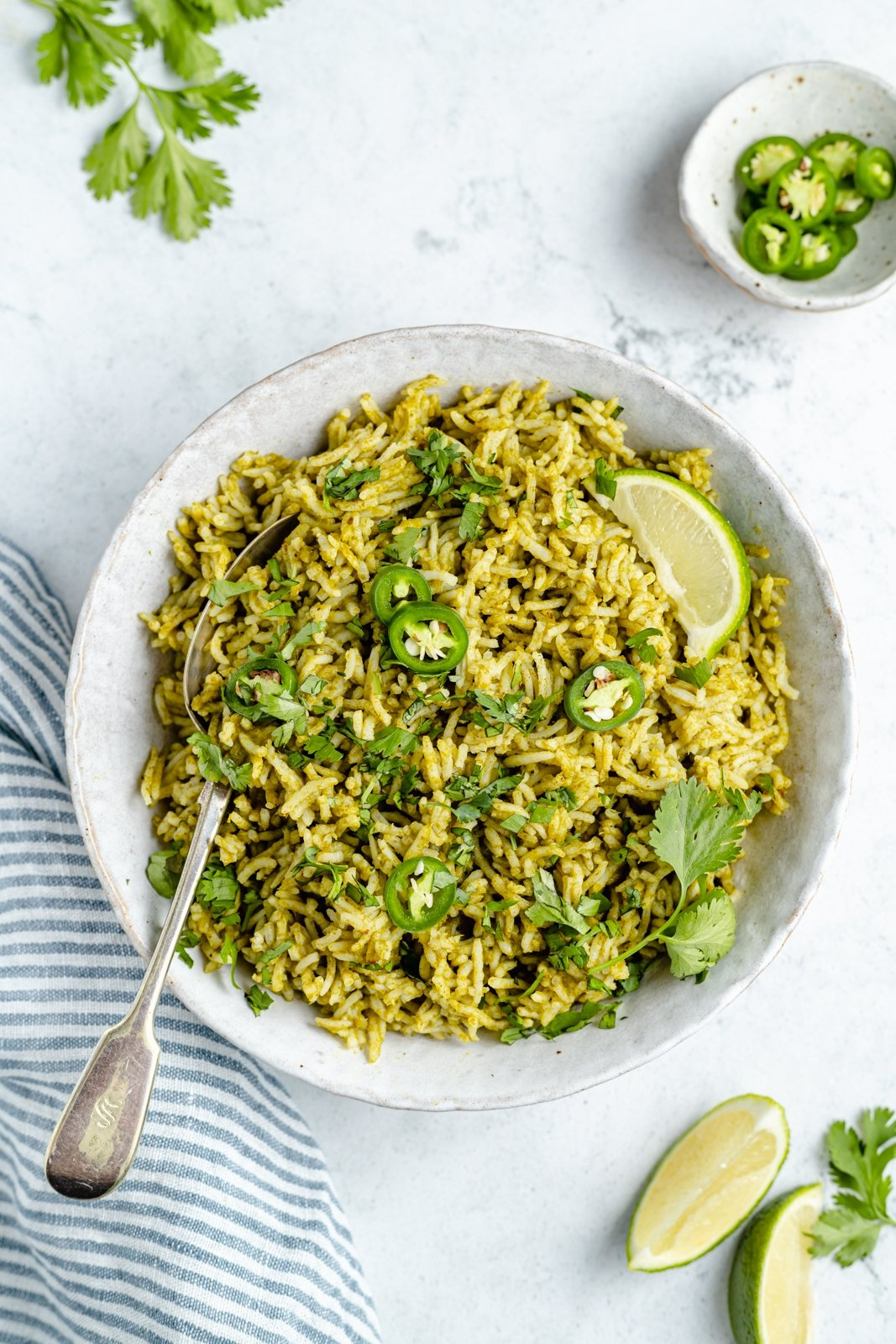 arroz verde in a bowl with a spoon