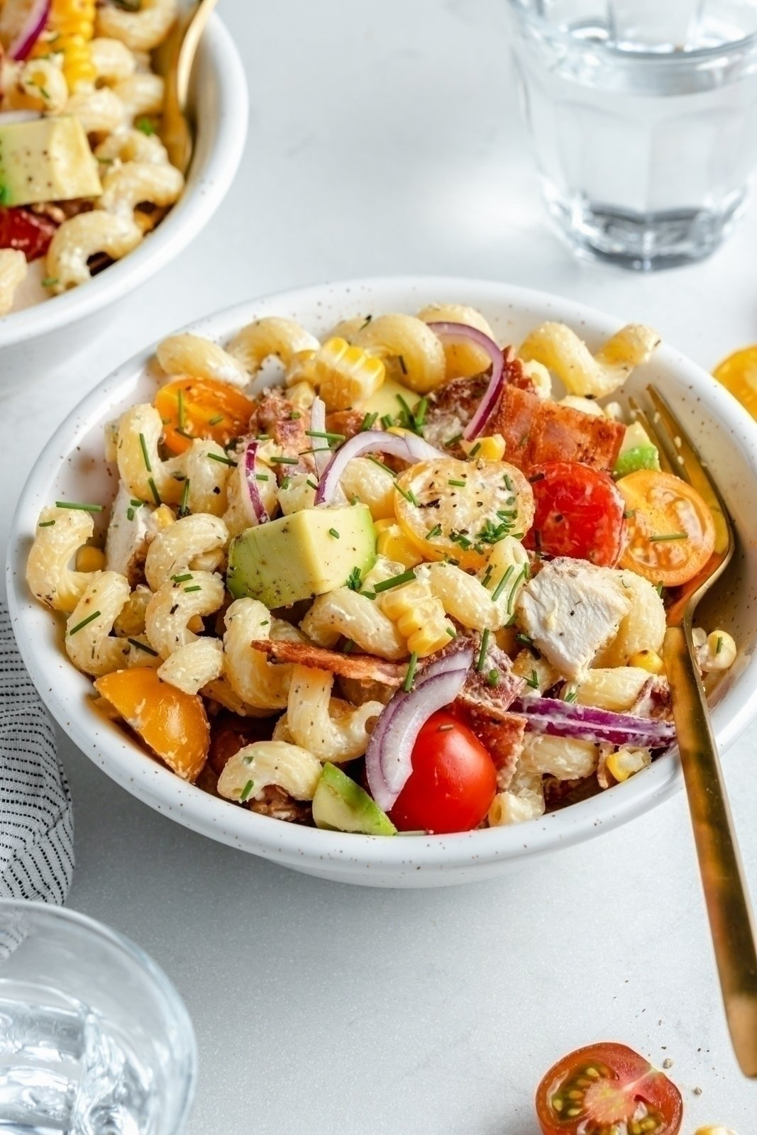 grilled chicken bacon pasta salad in a bowl with a fork